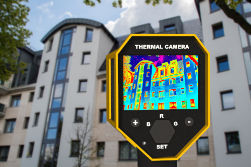 Outside an apartment building, a person holds up a thermal imaging camera showing